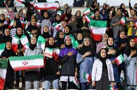Iranian women sing their national anthem at Tehran's Azadi Stadium just before the Iranian men's national team kicked off against Bolivia in a friendly soccer match, Oct. 16, 2018. It was the first time in decades that an organized group of Iranian w