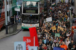 Hundreds of anti-government protesters march during an annual New Year protest in Hong Kong, Tuesday, Jan. 1, 2019.