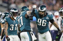 FILE - Philadelphia Eagles Malcolm Jenkins #27 celebrates with Derek Barnett #96 after a hit against New England Patriots Brandin Cooks at Super Bowl 52, February 4, 2018, in Minneapolis.