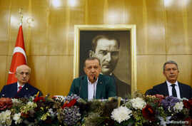 Turkish President Tayyip Erdogan, accompanied by Parliament Speaker Ismail Kahraman and Chief of Staff, General Hulusi Akar, speaks during a news conference at Ataturk airport in Istanbul, Turkey, Sept. 17, 2017.