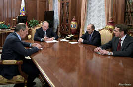 Russia's President Vladimir Putin, second from left,  Foreign Minister Sergei Lavrov, left,  Director of Russian Federal Security Service  Alexander Bortnikov, second from right, and Director of Foreign Intelligence Service Sergei Naryshkin hold a me
