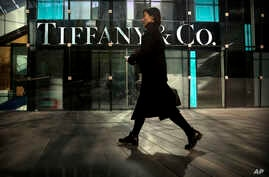 FILE - A woman walks past a Tiffany & Co. store at a shopping mall in Beijing, Nov. 29, 2018.