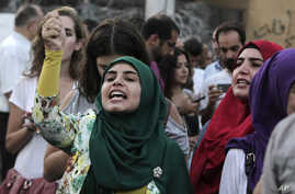 Protesters attend an anti-government rally in downtown Beirut, Lebanon, Sept. 2, 2015.