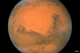 The Hubble Space Telescope took this close-up of Mars when it was just 88 million kilometers away. This image was assembled from a series of exposures taken over 36 hours. (NASA)