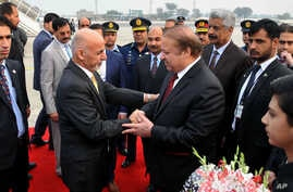 Pakistani Prime Minister Nawaz Sharif, center right, greets Afghan President Ashraf Ghani, center left, upon his arrival at Nur Khan airbase in Rawalpindi, Pakistan, Dec. 9, 2015.