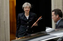 British Prime Minister Theresa May leaves 10 Downing Street to deliver a statement on Brexit to Parliament in London, Oct. 9, 2017.