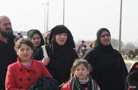 """As these women flee fighting in Mosul, they remove IS-mandated face veils.  Locals say many young women married family friends or relatives under IS, for fear that if they were unmarried, an IS militant would demand to """"marry"""" them, Jan. 14, 2017 in"""