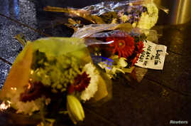 Flowers are laid at the scene after an attack on Westminster Bridge in London, March 22, 2017.