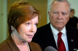 FILE - In this Thursday, Oct. 16, 2014 file photo, Brenda Fitzgerald, Georgia Department of Public Health commissioner, left, and Gov. Nathan Deal respond to questions about Ebola victims at Emory University Hospital.