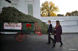 First Lady Melania Trump and her son Barron Trump welcome the official White House Christmas Tree, a Wisconsin-grown tree provided by the Chapman family of Silent Night Evergreens, to the White House in Washington, Nov. 20, 2017.
