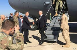 U.S. Secretary of Defense Jim Mattis, center, is greeted by U.S. Ambassador Douglas Silliman as he arrives at Baghdad International Airport on an unannounced trip, Feb. 20, 2017.