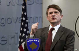 FILE - U.S. Deputy Assistant Secretary Tom Countryman gestures during a news conference in Kosovo, capital Pristina, Feb. 12, 2011.