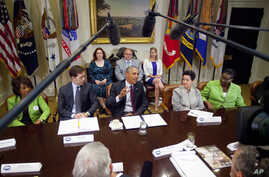 President Barack Obama talks during his meeting with small-business owners and members of Congress to discuss the importance of the reauthorization of the Export-Import Bank in the Roosevelt Room of the White House in Washington, July 22, 2015.