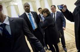 A US press pool reporter, woman at center, is escorted out after asking a question to Uzbek President Islam Karimov (not pictured) during a photo opportunity before a meeting with US Secretary of State John Kerry (not pictured) at the Palace of Forum