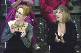 FILE - In this March 23, 2003, photo, actresses Meryl Streep, left, and Barbra Streisand applaud on stage during a reunion of past Oscar winners during the 75th Academy Awards in Los Angeles, California.