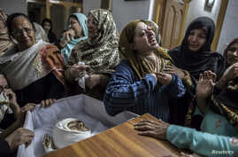 A mother mourns her son Mohammed Ali Khan, 15, a student who was killed during an attack by Taliban gunmen on the Army Public School, at her house in Peshawar, December 16, 2014.