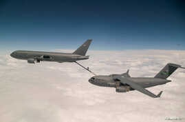 FILE - Boeing's KC-46 aerial refueling tanker conducts receiver compatibility tests with a U.S. Air Force C-17 Globemaster III from Joint Base Lewis-McChord, in Seattle, Washington, July 12, 2016. (Air Force/Handout via Reuters)