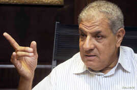 FILE - Egypt's outgoing Housing Minister Ibrahim Mahlab -- named as the country's new prime minister -- talks during an interview with the media in Cairo, September 2012.
