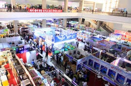 FILE - People attend the 20th Pyongyang Spring International Trade Fair in Pyongyang, North Korea, May 22, 2017. Countries participating in the fair include Belarus, China, Iran, Italy, Indonesia, Vietnam and Cuba.