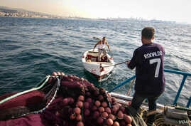Fishermen head out to sea off the coast of Beirut. They say fish spawning grounds have been destroyed by the land reclamation.