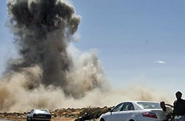 Gadhafi Forces Launch Airstrikes on Eastern Town