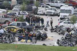 Authorities investigate a shooting in the parking lot of the Twin Peaks restaurant in Waco, Texas, May 17, 2015.