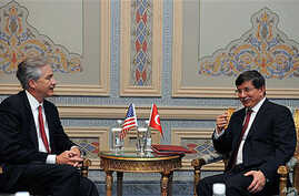 Turkish Foreign Minister Ahmet Davutoglu (R) and US Deputy Secretary of State William Burns speak after the Istanbul Conference for Afghanistan in Istanbul, Turkey, November 2011. (file photo)