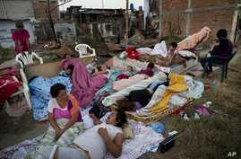 Four families wake up after sleeping outside their homes that collapsed during the earthquake in Manta, Ecuador, Tuesday, April 19, 2016. The strongest earthquake to hit Ecuador in decades flattened buildings and buckled highways along its Pacific co