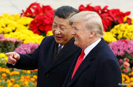 U.S. President Donald Trump and China's President Xi Jinping attend a welcoming ceremony in Beijing, Nov. 9, 2017.
