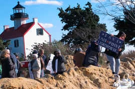 "Volunteers hold a ""Save The Lighthouse"" rally near the East Point Lighthouse in Maurice River Township, N.J., Nov. 10, 2018."