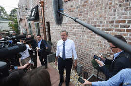 Republican presidential candidate, former Florida governor Jeb Bush, speaks to the media during a campaign stop, Nov. 17, 2015, in Florence, South Carolina.