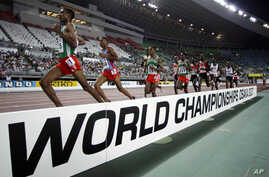 Ethiopia's Gbre-gziabher Gebrmariam, left, leads ahead of Eritrea's Zerenay Tadese, 2nd left, and Ethiopia's Kenenisa Bekele during Men's 10,000 meters race at the World Athletics Championships Monday, Aug. 27, 2007, in Osaka, Japan. Bekele won the g
