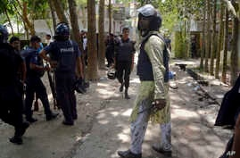 Bangladeshi policemen arrive near the scene of a blast in Kishoreganj, about 90 kilometers (60 miles) north of the capital of Dhaka, Bangladesh, July 7, 2016.