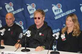 From left to right: Andre Agassi,  Elton John, and Steffi Graf at news conference