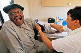 Archbishop Desmond Tutu, left, reacts as he is examined by a clinical nurse inside the 'Tutu Tester' mobile unit in Cape Town, South Africa, Thursday Oct. 22, 2009. The Tutu Tester, is a mobile unit that test people for diabetes, obesity and HIV with