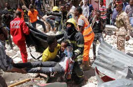 Rescuers carry away a man who was injured by a blast in the Somali capital of Mogadishu, Feb. 4, 2019.