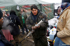 Oscar High Elk, 26, of the Cheyenne River Sioux Tribe, prays as he and other members of the tribe prepare to evacuate from the main opposition camp against the Dakota Access oil pipeline near Cannon Ball, N.D., Feb. 22, 2017.