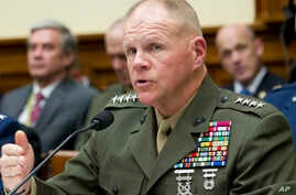 FILE - Marine Corps Commandant Gen. Robert B. Neller testifies on Capitol Hill in Washington, April 5, 2017, before the House Armed Services Committee hearing.