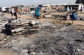 A general view shows the damage at a camp for displaced people after an attack by suspected members of the Islamist Boko Haram insurgency in Dalori, in northeast Nigeria, Nov. 1, 2018.