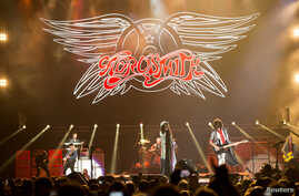 """FILE - Rock band Aerosmith performs during the """"Aerosmith: Let Rock Rule"""" tour at The Forum in Inglewood, California, July 30, 2014."""