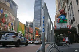 Crowd barriers are in place around Macy's as preparations continue for the Macy's Thanksgiving Day Parade in New York, Nov. 23, 2016, More than 80 New York City sanitation trucks filled with sand will be used along the route to create a physical barr...