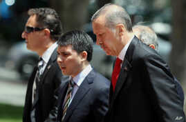 Turkish Prime Minister Recep Tayyip Erdogan, right, arrives for a cabinet meeting in his office in Ankara, Turkey, June 25, 2012.