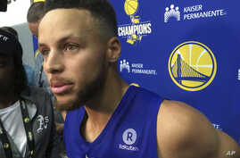 Golden State Warriors Stephen Curry takes questions from the media after NBA basketball practice in Oakland, California, Sept. 23, 2017..