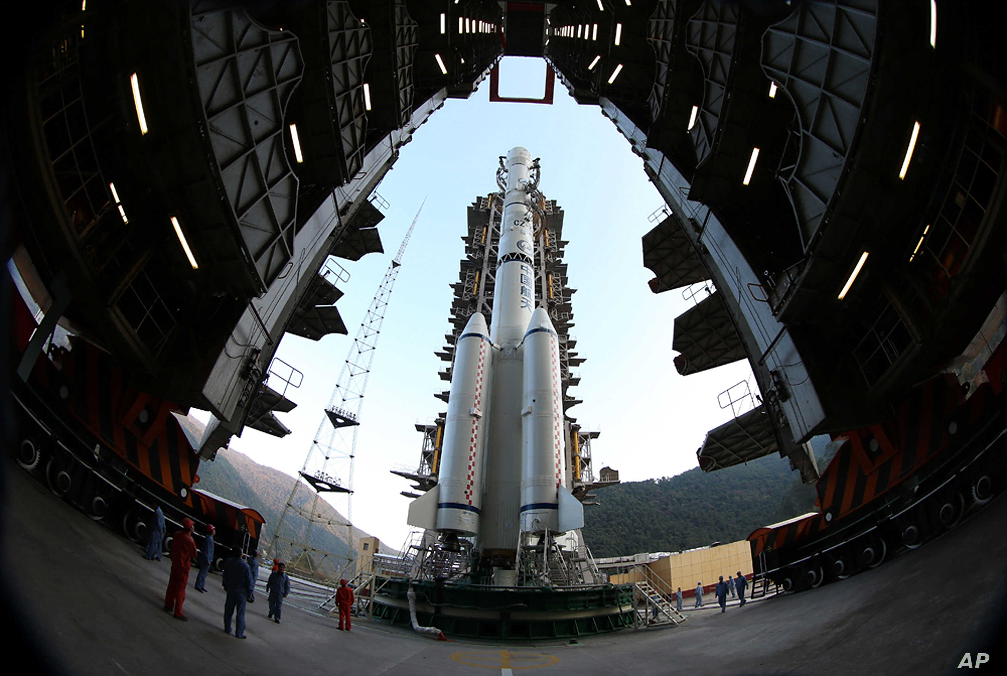 The Long March 3B rocket carrying the Chang'e-3 lunar probe is prepared for launch at the Xichang Satellite Launch Center in Xichang in southwest China's Sichuan province on Sunday, Dec. 1, 2013.