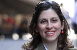 FILE - Iranian-British aid worker Nazanin Zaghari-Ratcliffe is seen in an undated photograph handed out by her family.