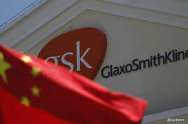 A Chinese national flag is seen in front of a GlaxoSmithKline office building in Shanghai, July 2013.