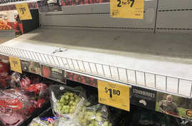 Empty shelves, normally stocked with strawberry punnets, are seen at a Coles Supermarket in Brisbane, Australia, Sept. 14, 2018.