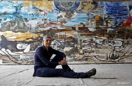 """Artist Jackie Kazarian poses for a portrait in front of her painting for """"Project 1915,"""" a commemorative piece marking the 100th anniversary of the Armenian genocide, in Chicago, Illinois, March 23, 2015."""