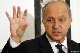 French Minister for Foreign Affairs Laurent Fabius speaks during a media conference in Tunis, May 14, 2013.