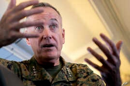 Joint Chiefs Chairman Gen. Joseph Dunford speaks to reporters aboard his plane, Aug. 12, 2017.
